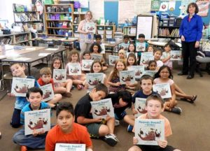 Lesley Burnap (left) and Author Melissa Stewart with Burnap's third-grade class at Calvin Coolidge Elementary School in Shrewsbury. Photo/Melanie Petrucci