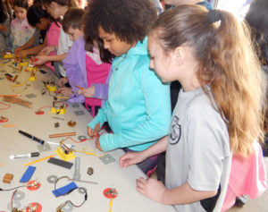 Photo 1: Fourth graders learn about conducting electricity. Photos Submitted