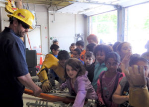 Photo 2: A SELCO employee teaches students about transformers. Photos Submitted