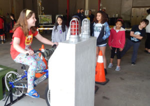 Photo 4: One fourth-grader generates energy with a bicycle. Photos Submitted