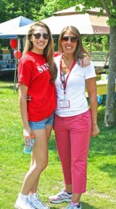 Andrea Loiseau, parent coordinator of the Class of 2016 picnic, takes a short break with her daughter Jaclyn.