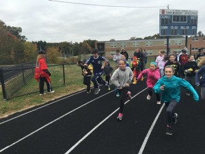 Students take part in the one-mile run around the track. (Photos/submitted)