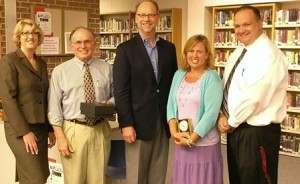 The Virtual High School (VHS) Collaborative presents Westborough High School staff members, Nicole Miller and Paul Vital, with an award for their longtime commitment to online learning at Westborough High and for helping expand educational opportunities for their students. (l to r) Carol Ribeiro, COO, VHS; Vital, Jeff Elliott, president and CEO, VHS; Miller and John Smith,  WHS principal