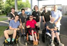 Students participated in a wheelchair race at L'Arche Community in Syracuse: (front) student Ronan O'Hara, L'Arche Community residents Brad and Mary; (back) students Ryan McDonnell, Declan Murphy, Donald 'DJ' Ormond and Luc Grenier, and history teacher Nick Argento. Photo/submitted
