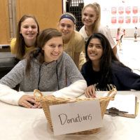 Genesis Club members (front) Alexa Vassilakis '20 (l) and Sanvi Sibbadi '21 and (back, l to r): Nikki Levine '21, Becky Plunkett '19, Madison Bromm '20. Photo/submitted