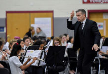 Evan Doyle, Band Director, Westborough High School, directs the Westborough High School band. Photos/Susan Forbes