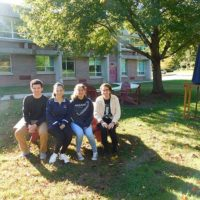 (l to r) Jack McGinn, Emma West, Miara Sasdi and Nicholas Smaldone in the outdoor classroom. Photo/Bonnie Adams