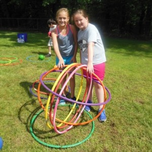 Taylor Mayo and Mia Bullard use teamwork to set up the spheres to knock out their opponents.