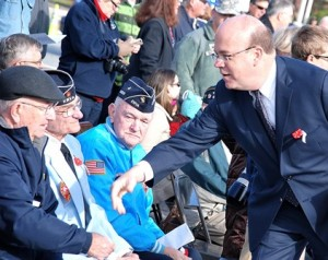 Prior to the dedication ceremony, (l to r) World War II veteran Dick Brodeur, and Korean War veterans Ken Swift and Jim McDonald meet U.S. Rep. Jim McGovern. Brodeur donated the American flag that was raised during the ceremony.