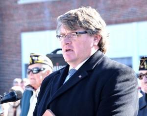 Selectman Jim Kane emcees the dedication ceremony.