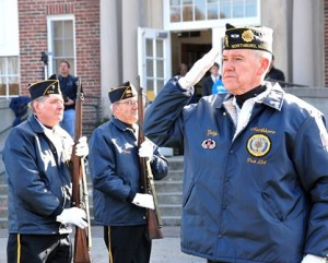 Standing at attention as the National Anthem is sung are members of Northborough's Vincent F. Picard American Legion Post 234 Color Guard: (l to r) Larry Shafer, Gerard Bourque and Bruce Goldsmith.