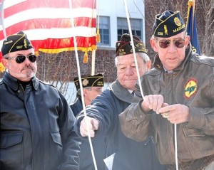Preparing to raise the American flag are (l to r) Commander Fred Russell of the Victor Quaranta American Legion Post 397 and Chair of the WWI Memorial Committee; Commander James Dunlevy of Charles Murphy VFW Post 10278; and Commander Walter Josti of Ray Stone American Legion Post 238.