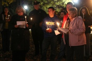 Members of the community attend a domestic violence vigil in Shrewsbury Oct. 16.