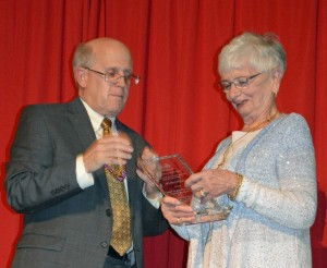 Chair of the Board of Directors of the Shrewsbury Youth and Family Services Tom Kennedy presents the Harry S. Cutting, Jr. award for community service to Elaine LeBlanc, director of human services for St. Anne's Church. (Photos/Joyce DeWallace)