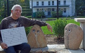 "Always on the search for unusual talent and creative artists, Shrewsbury philanthropist Robert ""Chief Joseph"" Terkanian found these stone faces, purchased them for inclusion in the Children's Courtyard, and gave them to the stone mason who fitted the smaller ones throughout the stone wall that encloses the area. These larger pieces will be placed as sculptures. Photo/Joyce DeWallace"