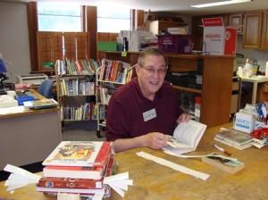 Shrewsbury resident Dean Gillam repaired a worn-out book for circulation as one of his many volunteer tasks at the Shrewsbury Library. (Photo/Lori Berkey)