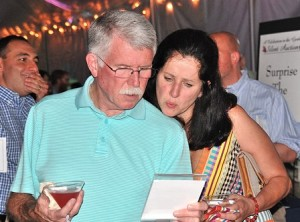 An item in the silent auction attracts the attention of Tim and Paulina Walsh.
