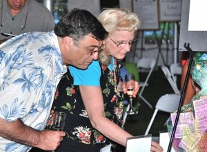 Bidding at the silent auction are Selectman Maurice DePalo and his wife, Barbara, a seventh-grade teacher at Oak Middle School.
