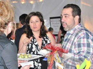 Deb and Paul Campaniello are served hors d'seuvres.