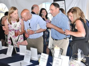 Making the rounds at the silent auction are (l to r) Michelle and Michael Papper with Jordan and Marci Rubi.
