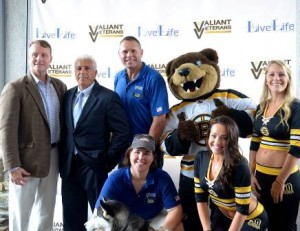 State Senator Michael Moore, Worcester Register of Probate Stephen Abraham, Rev. Will Bard, founder and CEO of LiveLife Center and Valiant Veterans, and Amanda Sullivan (front), executive director of LiveLife and executive director and co-founder of Valiant Veterans, with Boston Bruins mascot