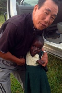 Nak-Sung Choi with one of the Soroti Vision School students