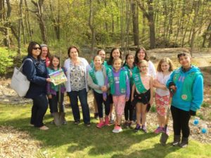 Members of Troop 30304 present a book and butterfly bush to Why Me & Sherry's House. (Photo/submitted)