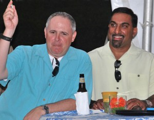Chris Fanale bids on a live auction item with support from Hari Ravindranathan.