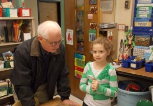 Ciara Marshall shows her desk to her grandfather Ed.