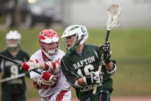 St. John's Liam Donovan tries to block Grafton's Ryan Tyldesley