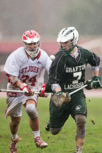 Grafton's Matt O'Brien and St. John's Connor Rocco chase after a loose ball