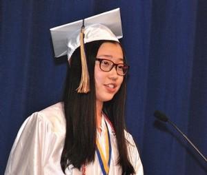 Valedictorian Catherine R. Zhang speaks to her classmates.