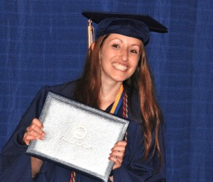 Caitlin Cullen walks off the stage with diploma in hand.