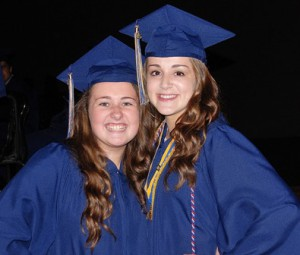 Erin Laverty and Danielle Kemp strike a pose before the graduation ceremony.