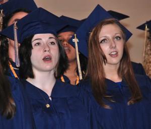 Fallon Lippoth and Jessica Watts sing with Senior Choir.