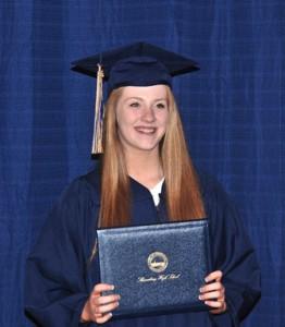 Shannon Bouffard displays her diploma.