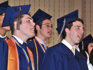 "(l to r) Ryan Beals, Dan Gil and Logan Edstrom sing ""Go the Distance."""