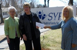 SYFS Director Terry Cassidy (center) accepts the donation check from SWC Community Outreach chairs Val Gannon (left) and Maureen Zingarelli.(Photo/submitted)