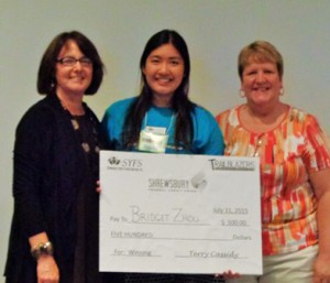(l to r) Lisa Raabe, representative for the Shrewsbury Federal Credit Union, Bridget Zhou, and Terry Cassidy, executive director, Shrewsbury Youth and Family Services.