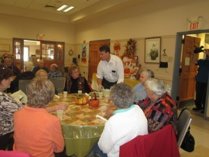Sen. Moore serves attendees at the Shrewsbury Senior Center's annual Thanksgiving Dinner. (Photo/Alexandra Molnar)