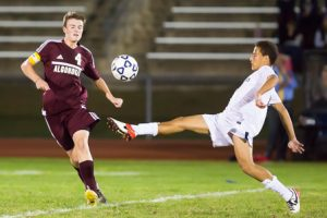 Shrewsbury's Rafael Macedo-Diaz stretches out to keep the ball away from Algonquin's Shawn Sullivan.