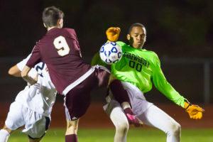 Algonquin's Alex Seno-Leo collides with Shrewsbury goalie Abdul Frederick as he tries to make a save.