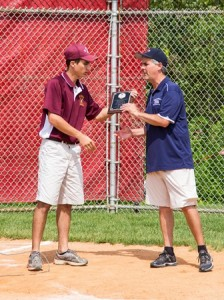 Shrewsbury National Manager Gary Thibeault accepts the championship plaque after winning Millbury's Thomas Dunford Memorial District Five 11-year-old Little League Baseball Tournament.