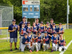 Shrewsbury National baseball players and coaches pose with their trophies after winning the championship.