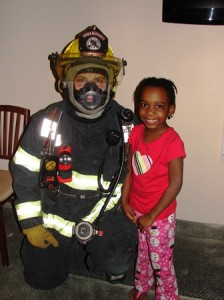 Shrewsbury Firefighter Rory Ahern demonstrates how his safety gear works with Phidelmil Castin, age 5.  Photo/Nance Ebert