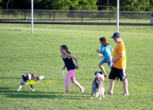 A few kids from the audience volunteered to help Piazza gather the Frisbees after each trick.