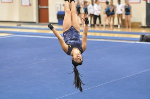 Yuen, a senior at Shrewsbury High School, is caught in mid-air during a tumbling pass.