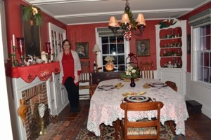 Helen Porter, who is a font of historic information, stands on original floor boards in the dining room of their 1846 farmhouse.