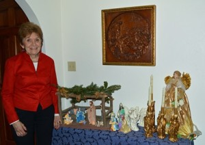 Christine Yablonski shows off one of the many nativity scenes that are part of her holiday decorations.
