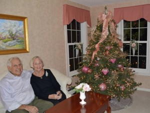Rocky and Anne Trotto enjoy a non-traditional pink and gold Christmas tree in their Colonial home.